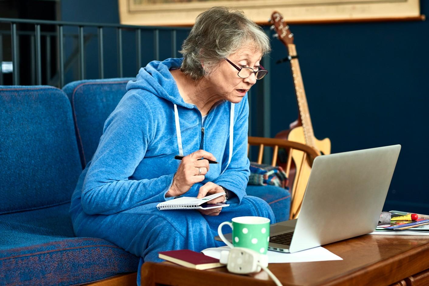 240723-1411x942-senior-woman-at-computer